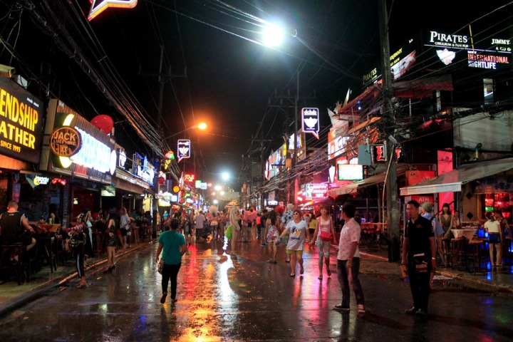 Neon signs flicker down Bangla Street, the main hub for nightlife in Patong Beach.