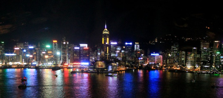 Hong Kong's famous skyline lights up the sky at night.