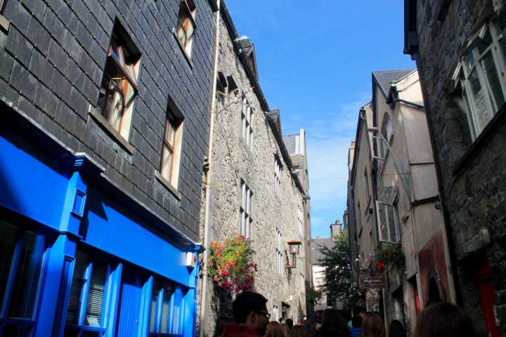 Sun shines through a back alley during a stroll through Galway town.