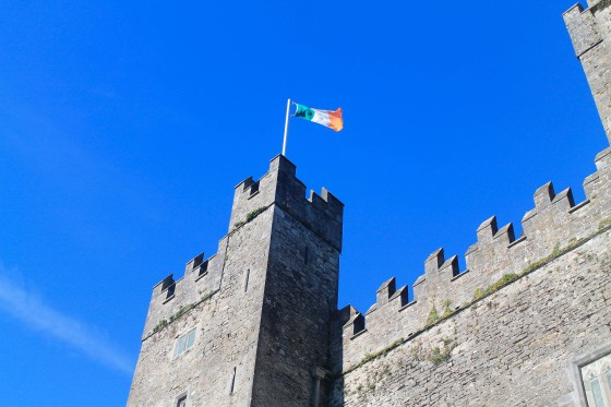 An Irish flag waves atop Bunratty Castle, a stopover between Limerick and Galway.
