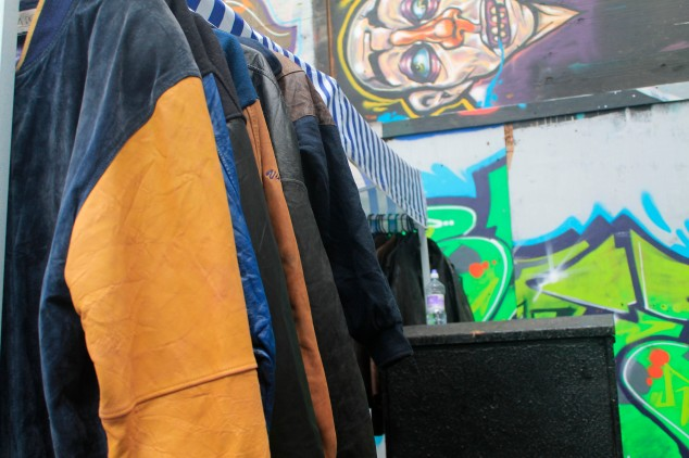 Street art and clothing stands make for a typical scene at Brick Lane's weekend market.
