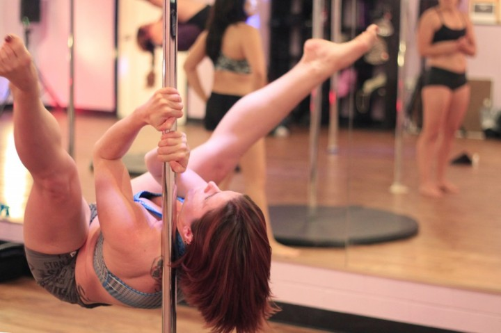 Brass Ovaries pole student Adrienne Foreman practices a move in the advanced pole class on Wednesday night. (Photo by Alex Vickery)