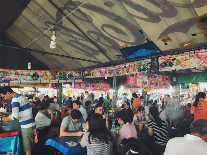 Bustling street food stalls at Chatuchak Market