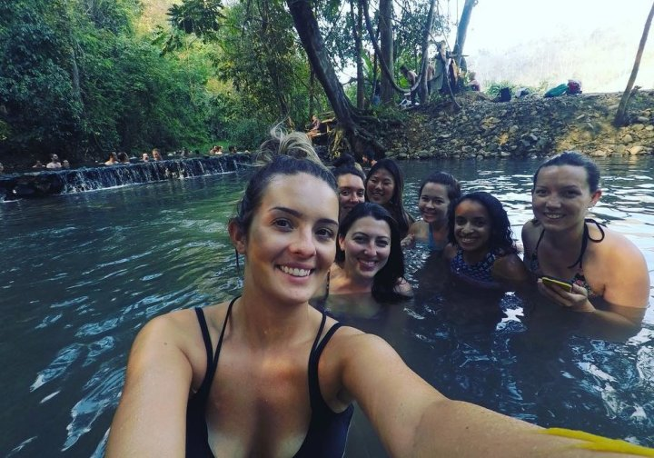 Every woman in this picture was traveling solo, so we organized a group trip to a hot springs in Pai, Thailand.