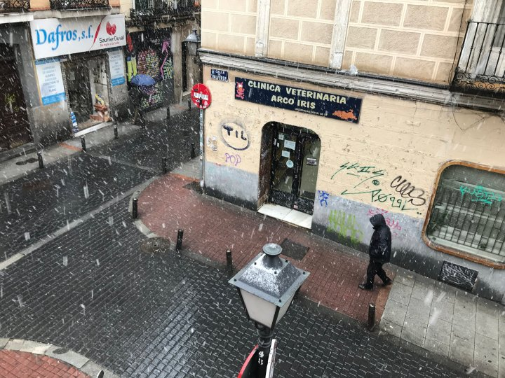 It's a rare, but beautiful occasion when it snows in the center of Madrid, Spain. View from my apartment in  Malasaña .