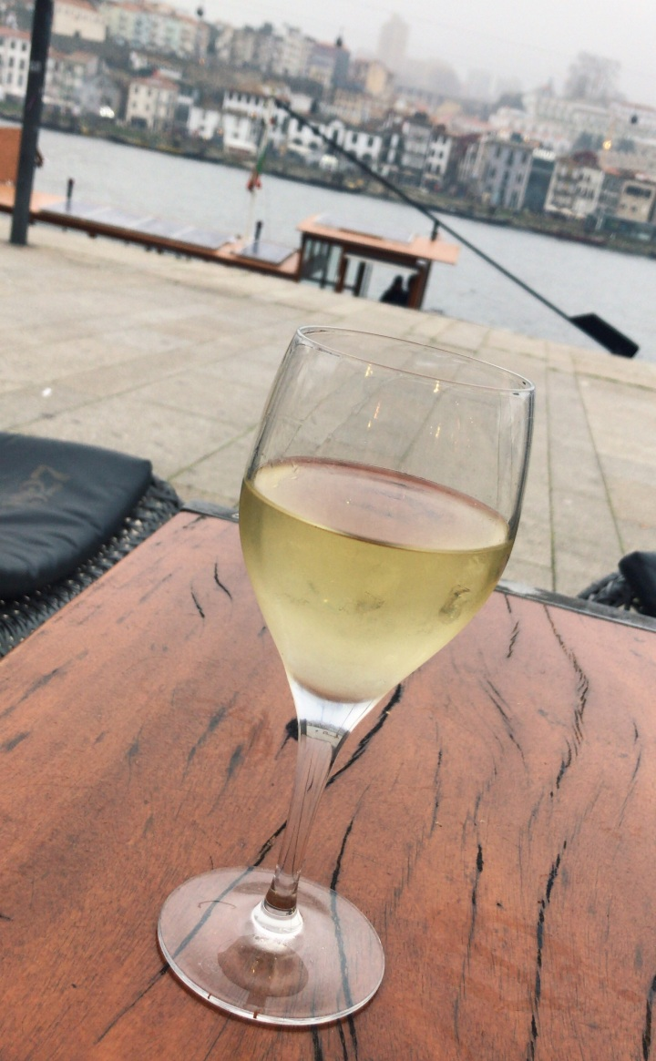 A glass of  vinho verde  overlooking the river at Coffee Pier.