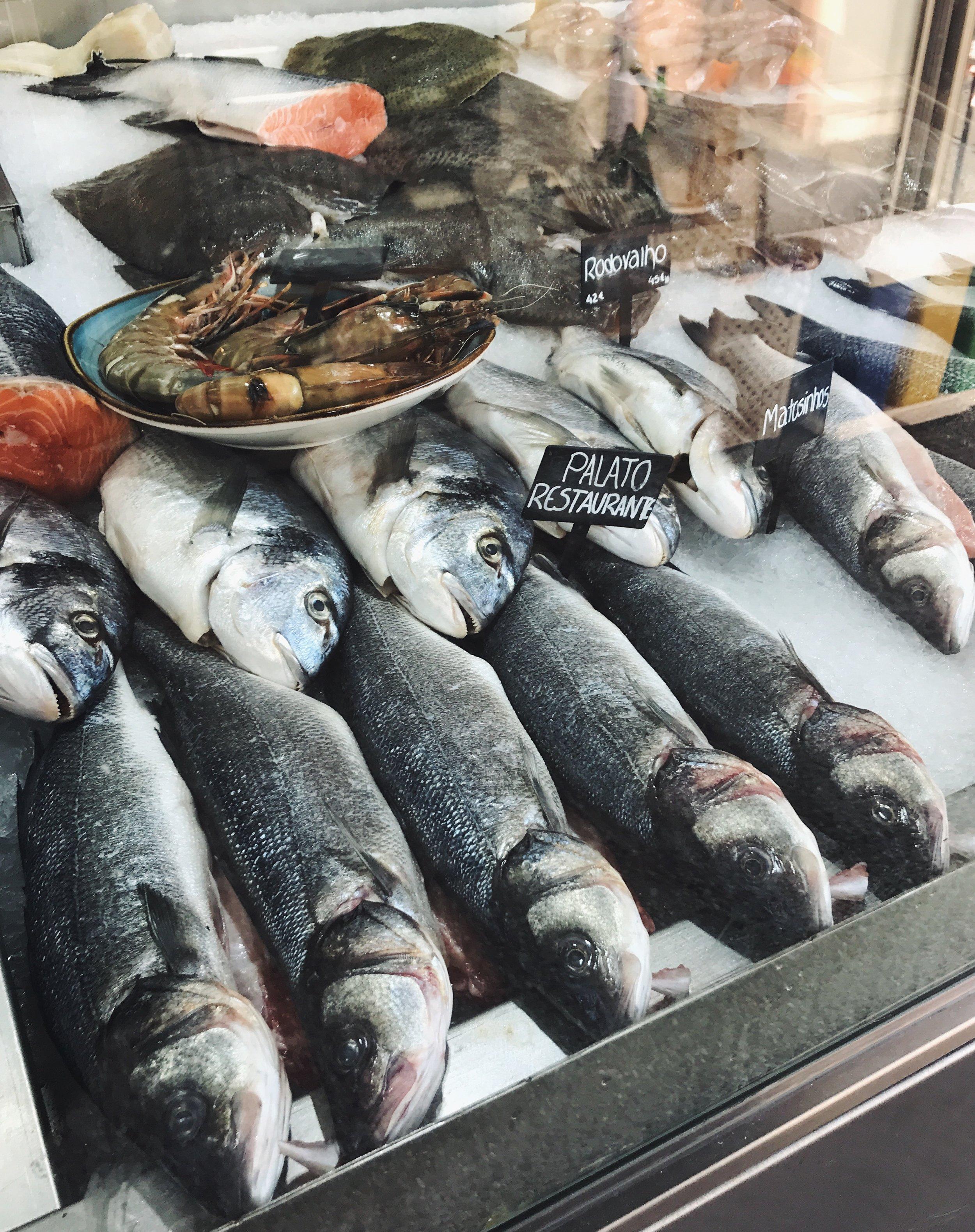 Bacalhau or cod fish on display at a restaurant on Rua Heróis de França.